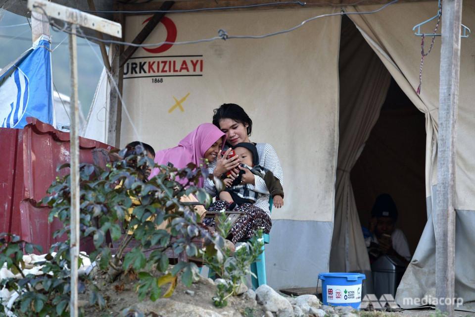 Setahun Usai Gempa dan Tsunami Palu, Media Asing Soroti Penanganan Para Korban - Foto 2